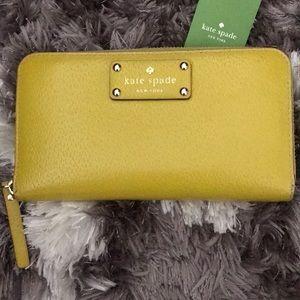 Kate Spade Zippy Wallet in Mustard Yellow